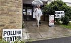 A woman leaves a polling station in Wiltshire.