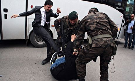 The image of Yusuf Yerkel kicking a protester that went viral. A government official said Yerkel apologised 'but it was too late'. Photograph: Stringer/Reuters