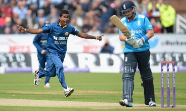 Nuwan Kulasekara of Sri Lanka celebrates dismissing Ian Bell of England.