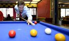 Liberal Democrat leader Nick Clegg plays pool at St Andrew's Youth Club in London