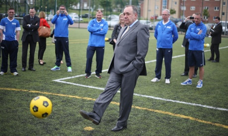 Scottish First Minister Alex Salmond takes a penalty with representatives of  Street Soccer Scotland, prior to a Scottish cabinet meeting at Fernhill community centre on Tuesday.