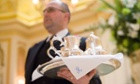 A waiter serves tea in the Palm Court at the Ritz Hotel London.