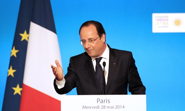 French President Francois Hollande gestures as he delivers a speech during a reception at the Elysee Palace in Paris on May 28, 2014, during the