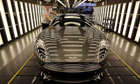 An Aston Martin Vanquish being inspected by hand