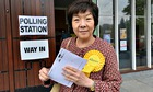 Alliance MLA Anna Lo places her vote at Cooke Centenary church in Belfast.