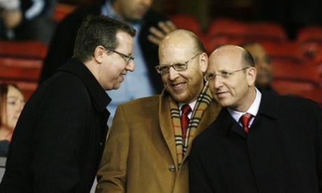 Bryan Glazer, Avi Glazer and Joel Glazer, here at Old Trafford, all have roles in the running of the Tampa Bay Buccaneers and Manchester United.