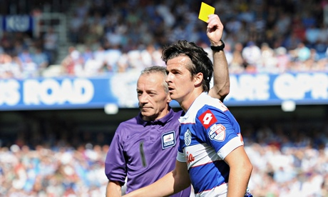QPR's Joey Barton is shown a yellow card