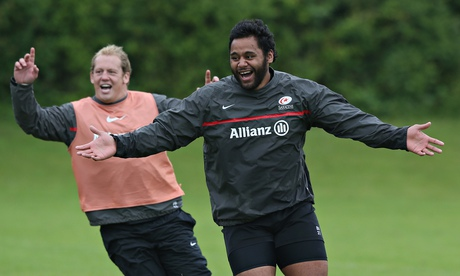 Billy Vunipola and Petrus du Plessis, left, warm up during a Saracens training session at St Albans