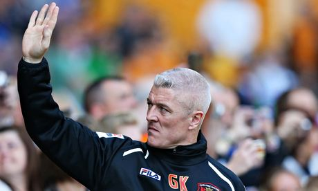 Graham Kavanagh, the Carlisle manager, waves to fans during his side's 3-0 defeat at Wolves.