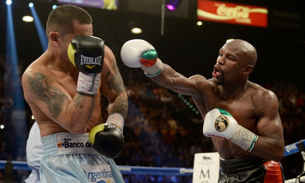 Floyd Mayweather Jr. throws a right at Marcos Maidana during their WBC/WBA welterweight unification fight at the MGM Grand Garden Arena on May 3, 2014 in Las Vegas, Nevada.