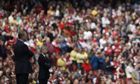 Arsène Wenger and Pepe Mel watch the 'action'.