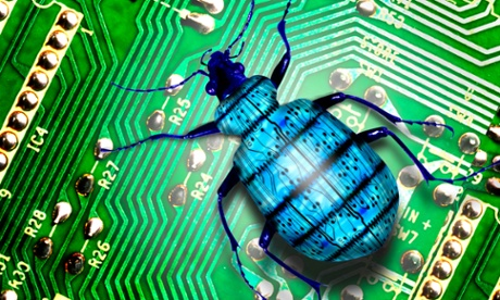 Blue creepy-crawly bug crawls over green electronic circuit