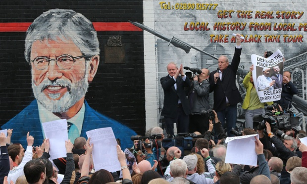 Sinn Fein's Martin McGuinness (top, left) and Bobby Storey (top, 3rd left) addressing Sinn Fein supporters attending the unveiling of Gerry Adams in the Falls Road, Belfast earlier this month.