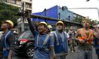 Workers look on after a strong earthquak