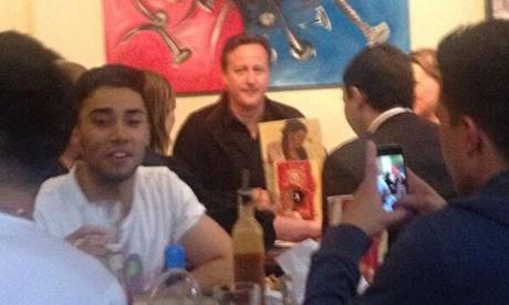 David Cameron in Nando's in Bristol. Photograph: @Melissabennett_  / Twitter