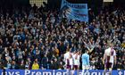 Fans hold a banner for Manuel Pellegrini