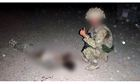 British soldier poses thumbs up with body of Taliban fighter in Afghanistan