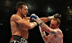 Carl Froch, left, jabs at George Groves in the world super-middleweight contest at Wembley