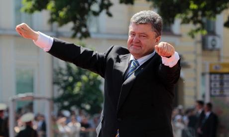Ukrainian President Petro Poroshenko lifts his arms in greeting after his inauguration ceremony in Sophia Square in Kiev, Ukraine, in June.