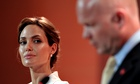 Angelina Jolie listens to William Hague at the Global Summit to End Sexual Violence in Conflict