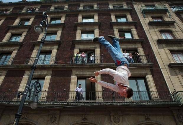 A circus performer does flips on a trampoline during a protest against a city law banning the use of animals in circuses in Mexico City's Zocalo. Acrobats, clowns and other circus employees are protesting Mexico City's new ban