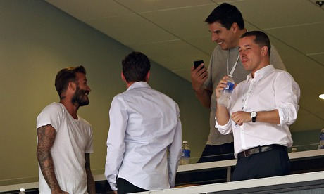 David Beckham and business partner Marcelo Claure watch England play Honduras in Miami