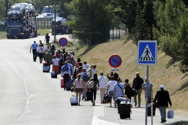 Passengers leave Marseilles Provence airport on foot after protesting taxis drivers blocked access.