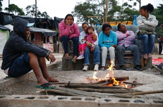 Keeping warm around a fire at the Homeless Workers Squatters Camp.
