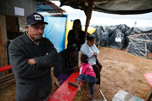 Crossed arms and defiant face in the camp