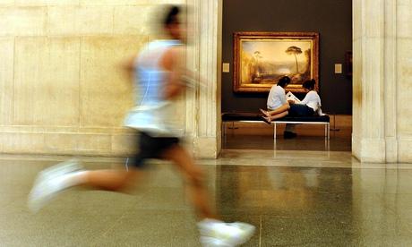 man sprinting through museum