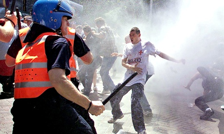 England football fans are sprayed with water cannon