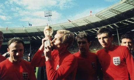England captain Bobby Moore kissing the Jules Rimet trophy as the team celebrate winning the 1966 World Cup final against Germany at Wembley Stadium. Also pictured, left to right, George Cohen, Geoff Hurst and Martin Peters.
