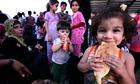 Iraqi families fleeing violence