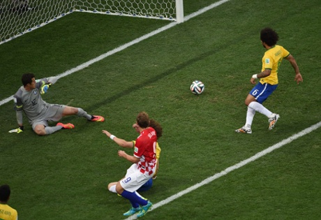 Brazil's defender Marcelo inadvertently turns the ball into his own net to give Croatia the lead.