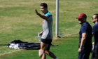 Portugal's Cristiano Ronaldo leaves a training session with ice on the left knee.