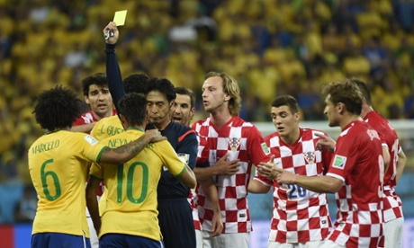 Neymar picks up the first yellow card for flinging his arm into the face of Luka Modric.