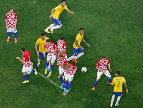 Croatia's play kleap from behind a line of vanishing spray as a free-kick is taken.