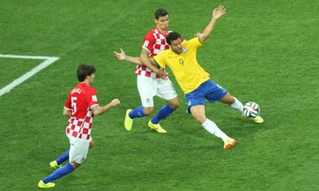 Croatia's Dejan Lovren fouls Brazil's Fred.