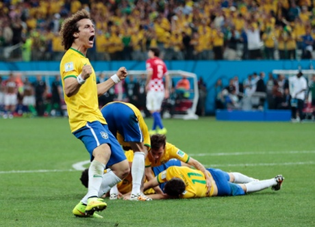 Brazil's players celebrate the third goal, which has sealed a 3-1 victory.