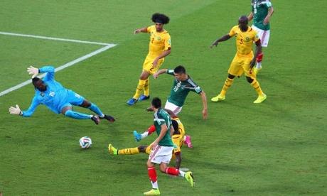 Oribe Peralta scores the opening goal past Charles Itandje.