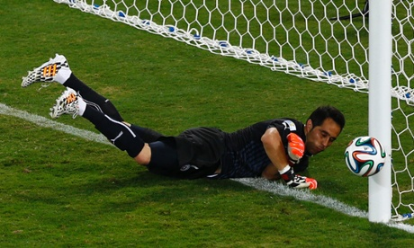 Chile's goalkeeper Claudio Bravo saves from Mark Bresciano's sweet strike.
