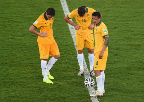 Mark Milligan, James Troisi and Tim Cahill look dejected after conceding a third goal.