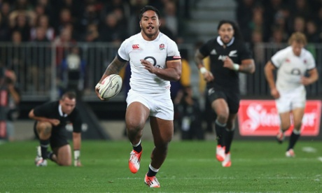 Manu Tuilagi of England breaks clear with the ball.
