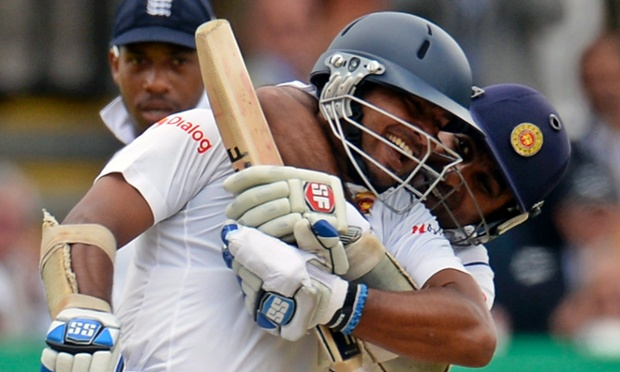 Sri Lanka's Kumar Sangakkara is embraced by his team-mate Mahela Jayawardena after completing his century in the first Test against England at Lord's.