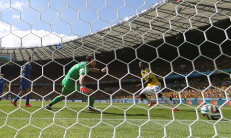 Colombia's Pablo Armero scores the opening goal past Greece's goalkeeper Orestis Karnezis.