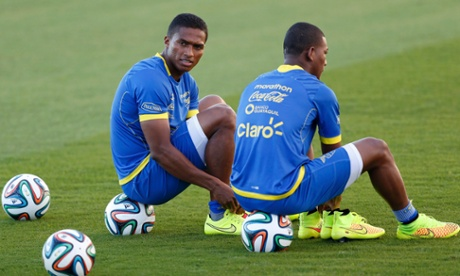 Ecuador's national soccer team player Antonio Valencia (L) sits on a ball during a training session.
