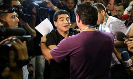 Diego Maradona greets a friend.