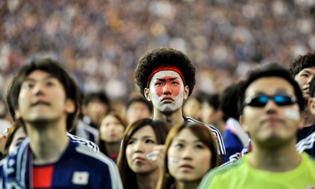 Japanese fans watching at Tokyo Dome react to Japan's defeat to Ivory Coast.