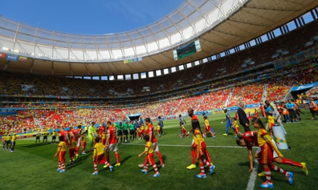 The team enter the pitch prior the World Cup Group E match between Switzerland and Ecuador at the Estadio Nacional in Brasilia.