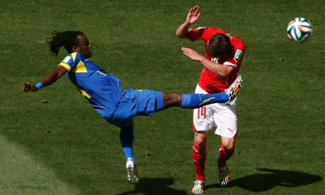 Ecuador's Juan Carlos Paredes fights for the ball with Switzerland's Valentin Stocker